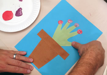 stamp flower centers with your thumb (or dad's!)
